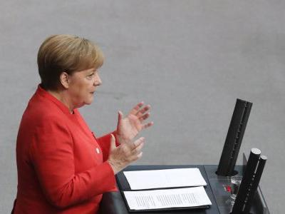 Germany's Merkel says migration deal is no about-turn