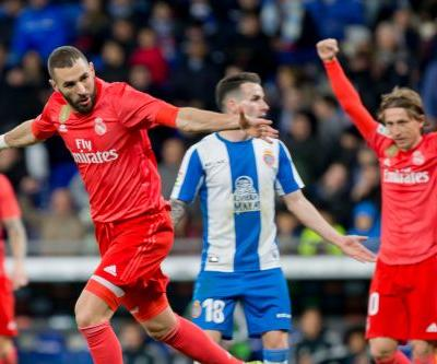 Benzema scores 2 as 10-man Madrid wins 4-2 at Espanyol