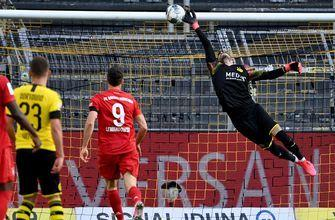 Roman Bürki keeps Dortmund in striking distance of Bayern with a pair of incredible saves