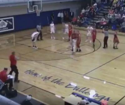 Basketball team caught swapping in different triplet for foul shot