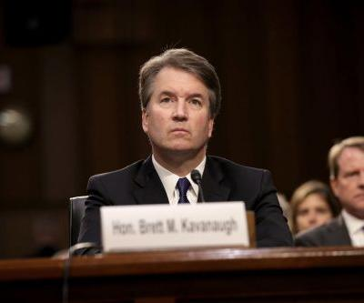 Brett Kavanaugh awaits fate as senators read FBI report