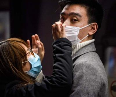 Hong Kong clamps down on travelers from China as coronavirus infections spike