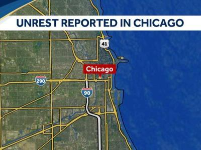 Shots fired as crowds clash with police in downtown Chicago