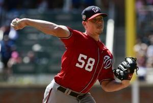 Hellickson leaves after reinjuring wrist while batting