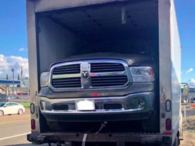 Police Pull Over a Box Truck With a Ram Pickup Squeezed Almost Impossibly Tight Inside