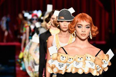 Moschino's paper doll inspired show is the coolest Fashion Week gimmick so far