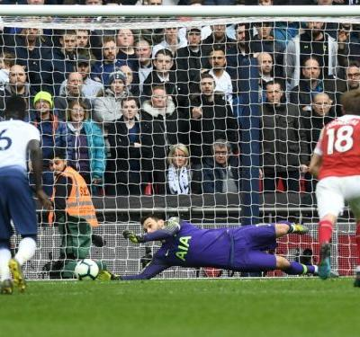 Tottenham 1 Arsenal 1: Lloris' late penalty save gives Spurs welcome relief