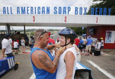 Adults take driver's seat and steer Soap Box Derby cars during parents race