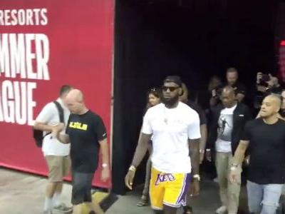 LeBron James - sporting Lakers shorts - receives standing ovation upon arrival at Summer League