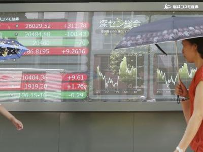 Asian shares mixed after China stabilizes currency