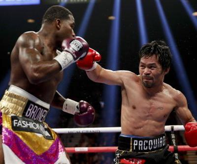 Manny Pacquiao rolled back the years to beat Adrien Broner in style, setting up a potential Floyd Mayweather rematch in the summer