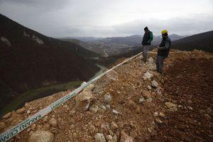 Lake created by coal waste landslide floods Bosnian highway