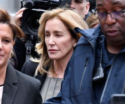 Felicity Huffman arrives in Boston court to plead guilty in college admissions scam