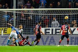 Napoli fights back to beat Genoa 2-1 and stay close to Juve