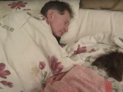 Couple Takes Turns Sleeping On Couch To Comfort Elderly Dog
