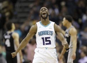 Walker says he'd take less than $221M to stay with Hornets