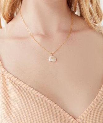 This Spring, Shell Pendants Might Just Replace Last Year's Coin Jewelry Obsession