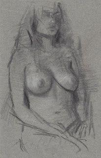 Sitting female nude model drawing from life