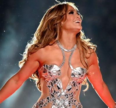 Jennifer Lopez wore 5 showstopping looks for her Super Bowl performance, and pulled off 4 seamless outfit changes onstage