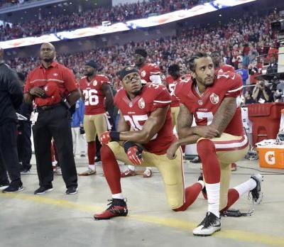 New NFL policy says players on field must stand for U.S. anthem or teams could face fines