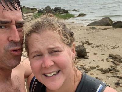 Amy Schumer Shares Sweet Beach Pics With Her Husband to Celebrate an ~Interesting~ Postpartum Milestone