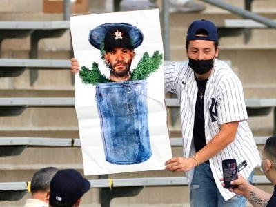 Yankees fans break out trash cans, taunts in first chance to jeer Astros