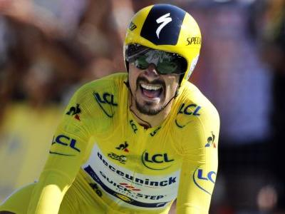 Alaphilippe wins time trial and keeps Tour yellow jersey
