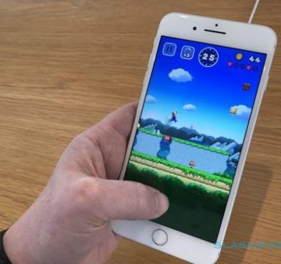 After years of sneering, Nintendo's going mobile