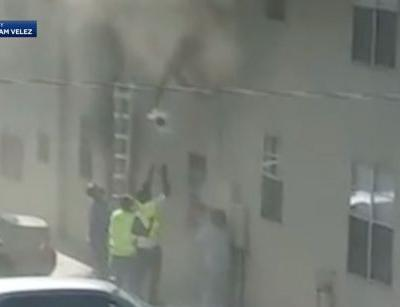 Dramatic video shows roofers rescuing baby, toddler from burning building