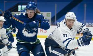 Canucks open 2-game set with 3-1 win over Maple Leafs