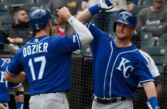 Dozier's homer in 10th lifts Royals over White Sox; ejections follow benches clearing