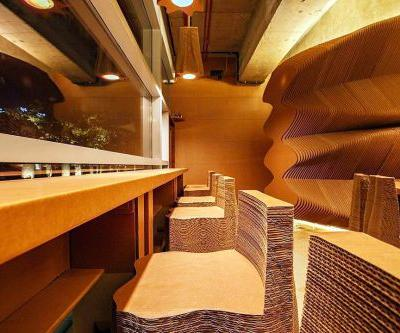 Architecture Firm NUDES Uses Corrugated Cardboard to Form the Furnishings and Walls of a Mumbai Cafe