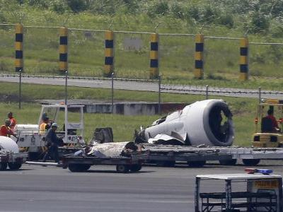 Plane skids off rainy Manila runway, rips off engine, wheel