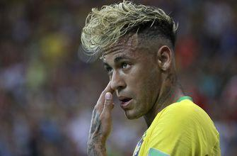 Neymar leaves Brazil training session limping