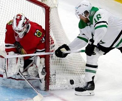 Blackhawks welcome fans back with 4-2 win over Stars