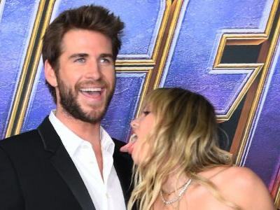 Miley Cyrus Licks Liam Hemsworth on the Red Carpet Because He's Such a 'Snack'