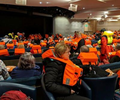 Tugs tow Norway cruise ship after 463 rescued; 17 injured