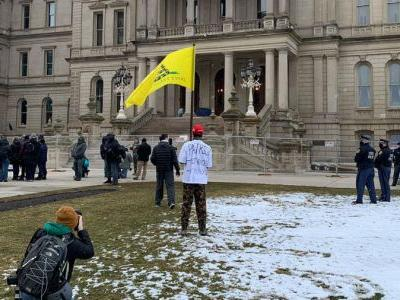Large police presence as a few protest outside Michigan Capitol