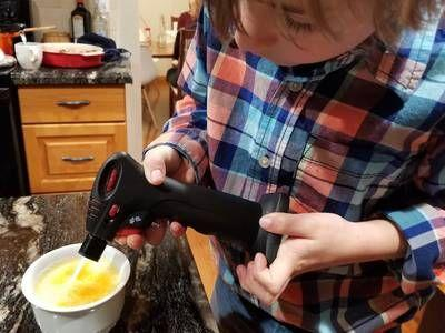 This kid dices onions and wields a kitchen torch