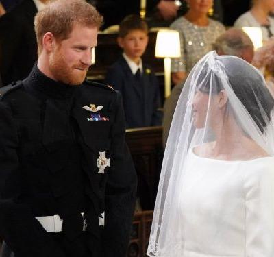 Prince Harry bit his lip after telling Meghan Markle she looked amazing at the royal wedding - and it's making everyone weak at the knees