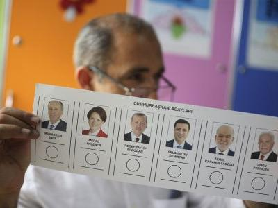 Erdogan seeks to cement power in Turkey's high-stakes votes