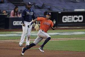 Springer, Astros beat Rays 7-4 to force Game 7 in ALCS