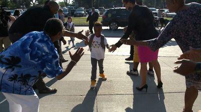 Fathers welcome students back to school for national Million Father March