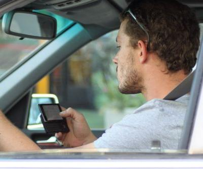 I kicked my habit of constantly checking my phone while driving - and ironically, technology helped me do it