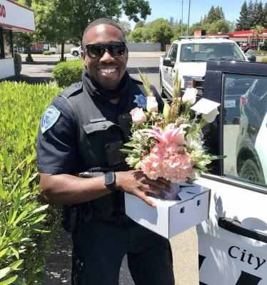 Police officers finish Mother's Day flower deliveries after arresting driver of suspected DUI in California