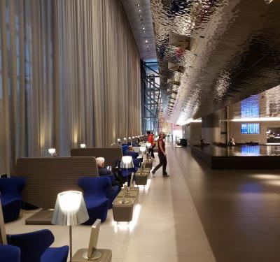 I spent a 4-hour layover at the massive Qatar Airways Flagship business class lounge in Doha, which sprawls across 2.5 acres and has a reflection pool. Here's what it's like