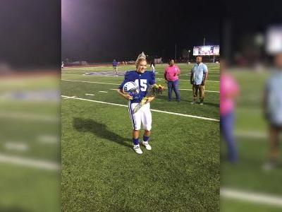 Homecoming queen ditches crown for helmet, kicks win for her team