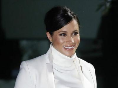 Meghan Markle Wore a Thing: White Calvin Klein Turtleneck Dress Edition