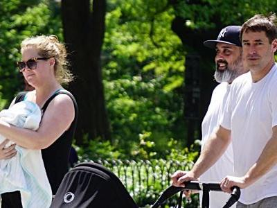 Amy Schumer and Husband Chris Fischer Take Baby Gene for a Walk in NYC