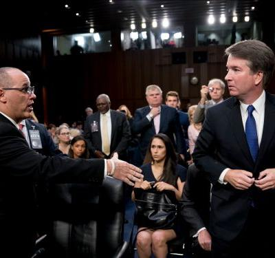 Video shows Brett Kavanaugh turned away as a Parkland shooting victim's father tries to to shake his hand - and people aren't sure what to make of it